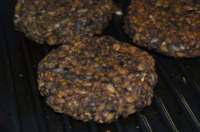 The patties I made today still cooking on the grill.